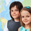 Children in geography class- focus on girl face — Stock Photo #71645763