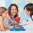 Kids having fun studying the solar system — Stock Photo #72783383