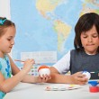 Kids painting the planets - for a solar system scale model — Stock Photo #72783385