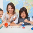 Kids making a scale model of the solar system in science class- — Stock Photo #72783393