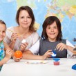 Science and art - kids making the scale model of solar system — Stock Photo #72783403