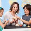 Kids in elementary science class study our solar system- focus o — Stock Photo #72783411