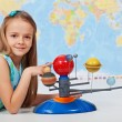 Young girl study solar system in science class — Stock Photo #72783431