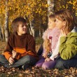 Family relaxing in the sunny autumn forest — Stock Photo #85028192