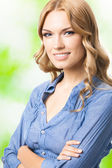 Happy smiling woman with long hair, outdoor — Stock Photo
