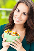 Young woman with salad, outdoors — Stock Photo