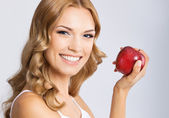 Woman with apple, on grey — Stock Photo