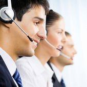 Three customer support phone operators — Stock Photo