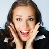 Surprised businesswoman, over blue — Stock Photo