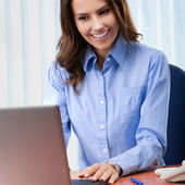 Young businesswoman working with laptop  — Stock Photo