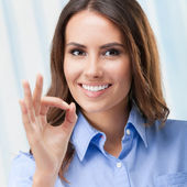 Businesswoman showing okay gesture, at office — Stock Photo