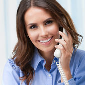 Young woman with phone, at office — Stock Photo