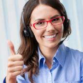 Support phone operator in headset with thumbs up  — Stock Photo