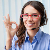 Support phone operator in headset, showing okay gesture — Foto Stock