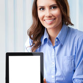 Businesswoman showing blank tablet pc, at office — Stock Photo