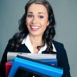 Businesswoman with folders, on gray — Stock Photo #53766227