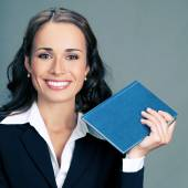 Businesswoman with notepad or organizer — Stock Photo