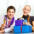 Two businesspeople with champagne and gifts — Stock Photo #53939037