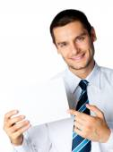 Young businessman showing signboard, on white — Stock Photo