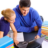 Young students with books and laptop studying — Foto de Stock