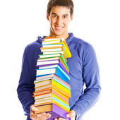 Isolated young happy smiling man with textbooks — Stock Photo