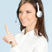 Support phone operator pointing, over blue — Foto de Stock