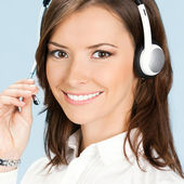 Support phone operator in headset, on blue — Stock Photo