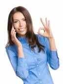 Woman with cellphone and okay hand sign — Stock Photo