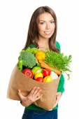 Woman with bag of vegetarian food, on white — Stock Photo