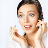 Business woman with cell phone, at office — Stock Photo