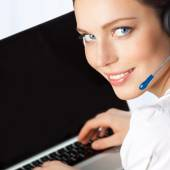 Phone operator in headset with laptop, at office  — Stock Photo