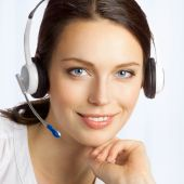 Support phone operator in headset, at office — Stock Photo