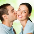 Happy young couple kissing, outdoor — Stock Photo #56465745