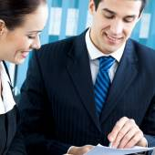 Two happy businesspeople working together at office — Foto de Stock