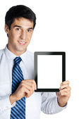 Businessman showing blank taplet pc monitor, isolated — Stock Photo