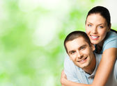 Portrait of young happy couple, outdoor — Stock Photo