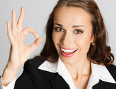 Businesswoman with okay gesture, over grey — Stock Photo