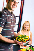 Young attractive happy couple at kitchen — Stock Photo