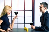Young happy couple celebrating with red wine, indoors — Stockfoto
