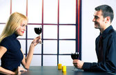 Young happy couple celebrating with red wine, indoors — Stock Photo