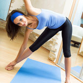 Happy smiling woman exercising at home — Stock Photo