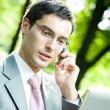 Business man working with laptop and cellphone, outdoors — Stock Photo #56657069