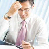 Businessman with documents at office — Stock Photo
