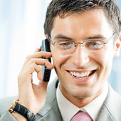 Businessman with phone at office — Stock Photo