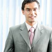 Portrait of successful businessman at office — Stock Photo