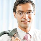 Portrait of young successful businessman at office — Stock Photo