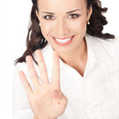 Businesswoman showing four fingers, on white — Stock Photo