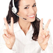 Support operator showing two fingers, on white — Stock Photo