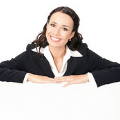 Businesswoman showing blank signboard, on white  — Stock Photo