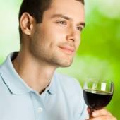 Portrait of man with glass of redwine — Stock Photo